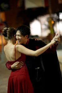 Ben Ren shares a laugh with his dance partner during an Argentine Tango event.